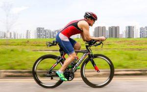 triathlete, triathlon, ironman, cycling, road cycling, lower back pain, lower back ache, strength training, barbell training